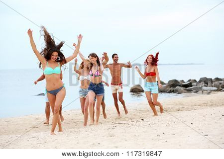 Beautiful young people having fun on beach