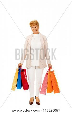 Happy business woman holging shopping bags
