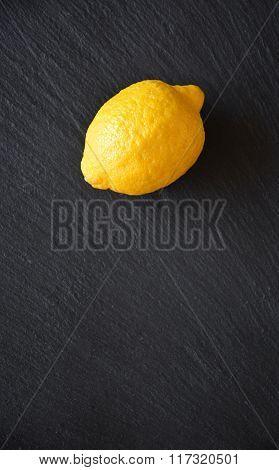 Lemon On A Black Slate Table