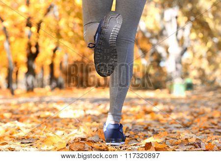 Runner legs outside during autumn day.