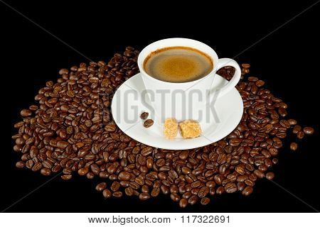 Coffee cup and coffee beans isolated on black background