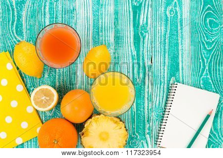 fresh juice in glass from citrus fruits