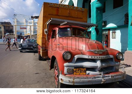 Classic American truck in a busy street in the center of Havana, Cuba.
