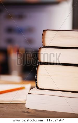 Books Stacked On The Desk