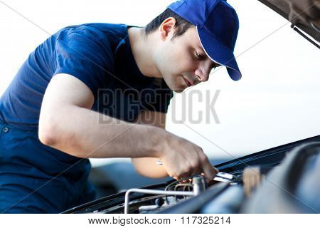 Mechanic fixing a car engine