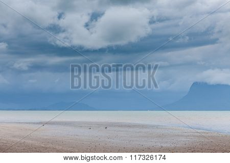 Deserted beach and stormy sky