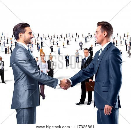 shaking hands on a background of a large group of people