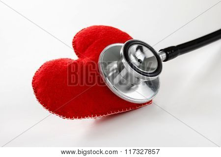 Red Heart And A Stethoscope On White Background