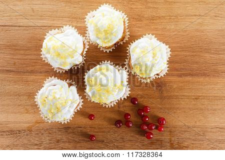 Cranberry Muffins On Wooden Background.