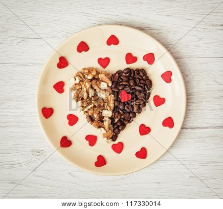 Shape Heart Of Coffee Beans And Peeled Walnuts With Many Little Red Hearts On The Plate, Valentine's