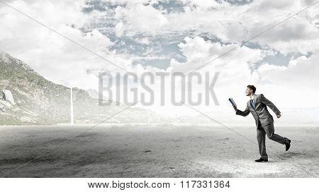 Man reading on the run