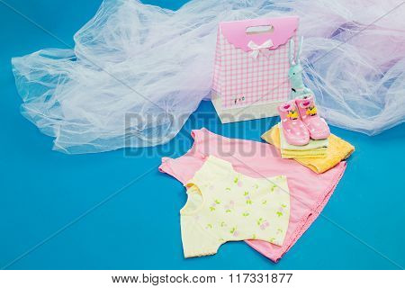 The baby clothes with a  gift box