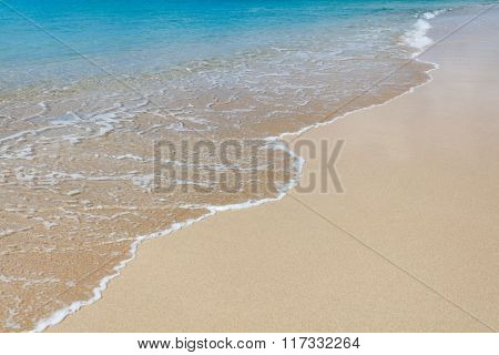 Background of a tropical white sand with a ocean wave