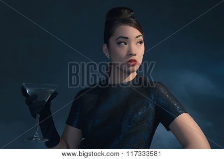 Retro 40S Styled Asian Woman In Evening Dress With Cocktail Glass.