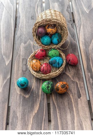 Quail Eggs In A Basket On A Wooden Background