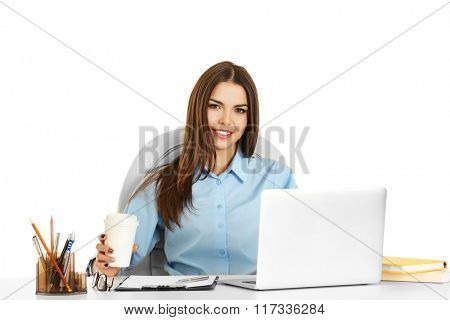 A beautiful woman with a cup of coffee working at the office, isolated on white