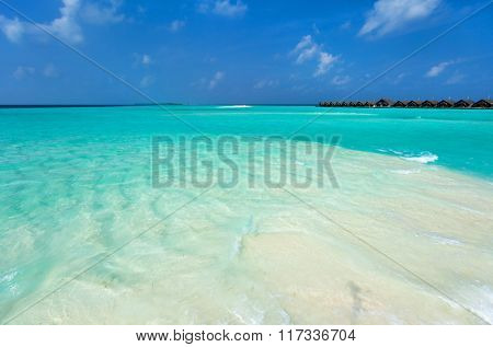 Perfect white sand beach and turquoise tropical ocean