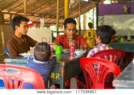 KOH CHANG, THAILAND - FEB 8, 2016: Unidentified children in the classroom at lunch time at school by project Cambodian Kids Care to help deprived children on Koh Chang island.