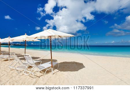 Row of chairs and umbrellas on a beautiful tropical beach at Anguilla, Caribbean
