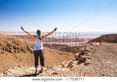 Happy woman relax in hot israel desert