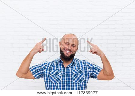 Casual Bald Bearded Business Man Smiling Point Fingers Up Head