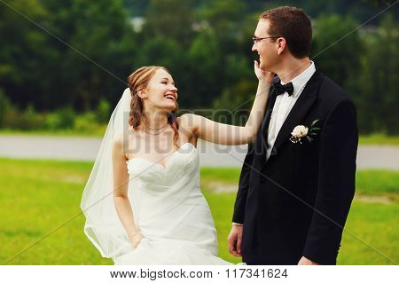 Happy Cute Elegant Couple On The Background Amazing Green Spring Fild