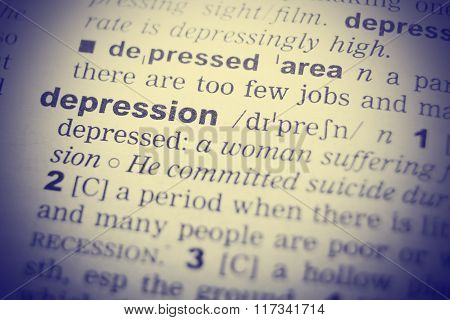 Close-up of word in English dictionary. Depression, definition and transcription
