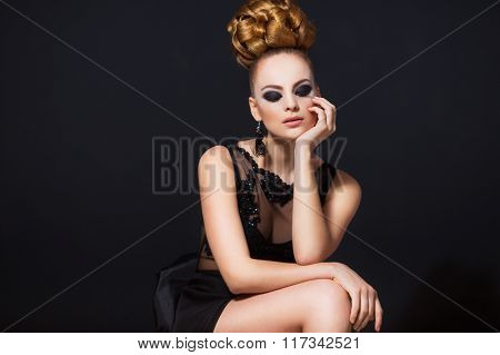 Hot young woman model with sexy lips makeup, strong eyebrows, clean shiny skin and bun hairstyle. Be