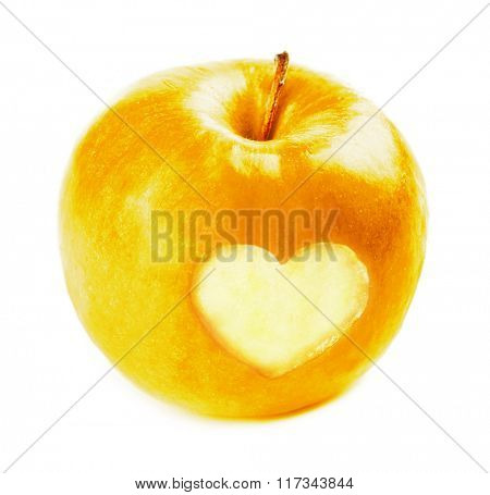 Yellow apple with heart isolated on white