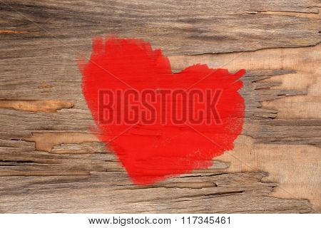 Red heart painted on old wooden wall background