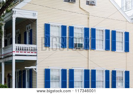Blue Shutters On Yellow Siding Home