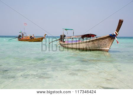 Traditional Thai boat cruise on the coast of the Bamboo island in the Andaman Sea, Thailand