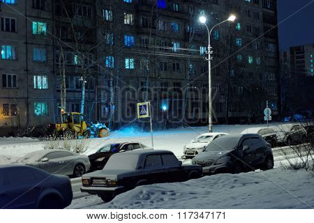 ST. PETERSBURG, RUSSIA - FEBRUARY 3, 2016: Snowblower at work on the street. 793 machines are worked in snow clearance in the city this night