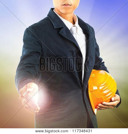 Portrait Of Working Engineering Man Standing With Safety Helmet With Welcome Hand