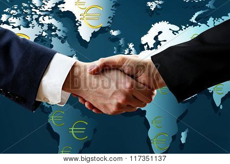 Business success strategy concept.Business handshake on world map background