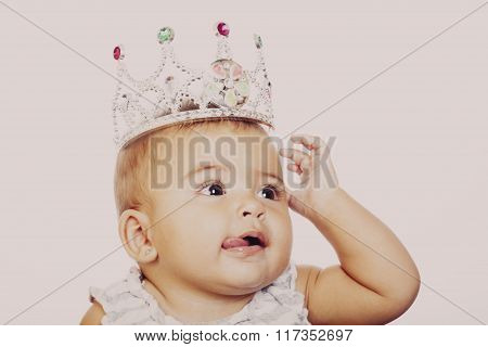Close-up Of Little Girl Wearing Fancy Crown