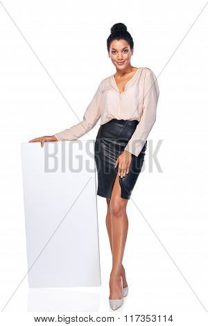 Smiling businesswoman with banner