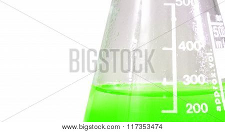 Laboratory flask with toxic green liquid and a millilitre scale
