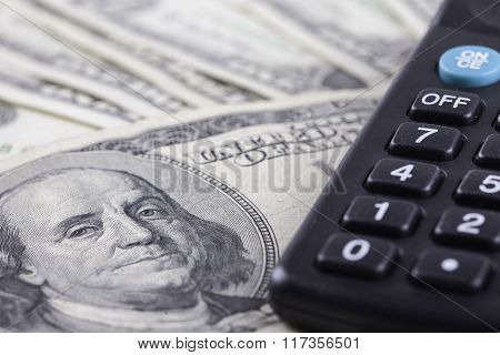 calculator and american dollars banknotes closeup