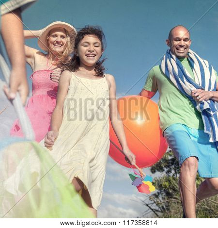 Cheerful Family Going to the Beach Holiday Enjoying Concept