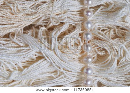 photo of pearl string on thread background