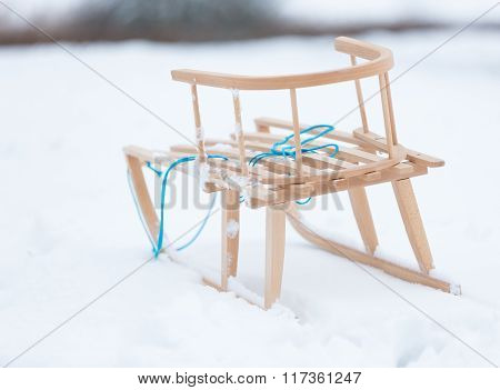 Sled Lying On Snow In Winter