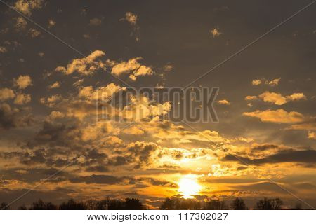 Dramatic Golden Sunset With Clouds