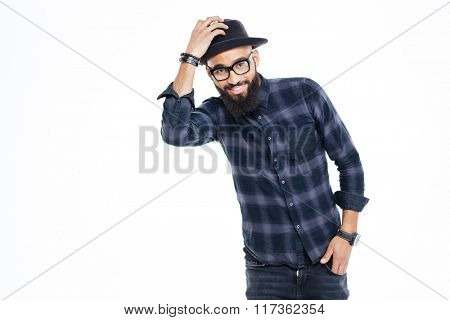 Happy bearded young african man in black hat and glasses standing and smiling