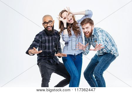 Group of students in casual clothes laughing and having fun