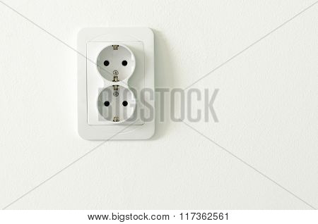 European White Electrical Outlet Socket On White Wall
