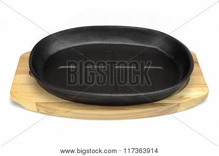 Cast Iron Serving Griddles Pan On Wood Plate White Isolated