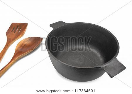 Empty Cast Iron Pot, Wooden Spatula And  Serving Spoon Isolated
