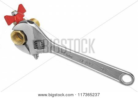 Ball Valve Grabbed With Adjustable Wrench Isolated On White Background