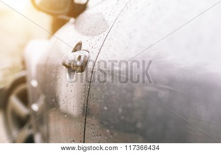 Close Up On A Sport Car Door And Rain Drops